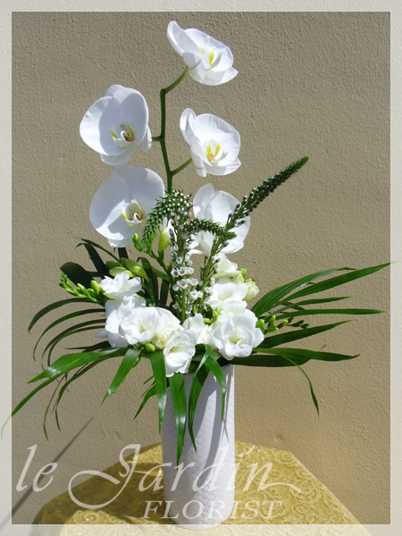 White green flower arrangements 561 627 8118 custom made upscale white flower arrangements mightylinksfo Image collections